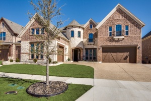 Upgraded Entry on this Windsor Model John R. Landon Signature Home Hip Pocket Listing in Richwoods.  Elevation cost at the time was close to $10,000