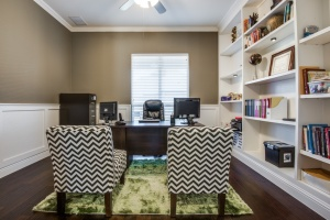 Study with upgraded cabinets and wainscoting.